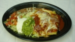 Enchiladas Maria - Three shredded beef enchiladas topped with cheese sauce and enchilada sauce. Served with lettuce, sour cream, guacamole, pico de gallo and your choice of rice or beans.